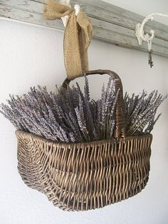love how this basket hangs from a piece of burlap
