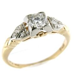 Art Deco circa 1930, 14k yellow gold and platinum engagement ring set with a transitional diamond weighing 0.33ct of SI1 clarity and G color.
