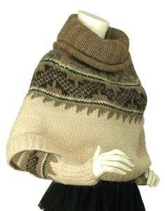 HERMES Gray/White Alpaca Suri Poncho With Sleeves   From a collection of rare vintage coats and outerwear at https://www.1stdibs.com/fashion/clothing/coats-outerwear/