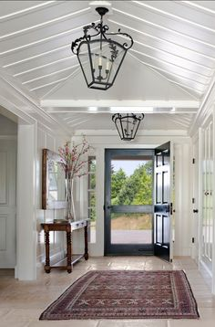 Fabulous entry and love the black door with side lights and the big lantern.