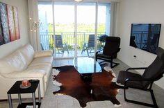 "Living room with queen size sleeper leather sofa and 55"" flat screen tv - Key West Top Floor Condo ""Seaside Breeze"" -Monthly -  - rentals"
