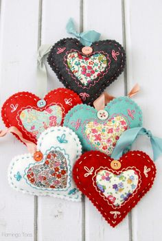 These are so sweet!  There is something so dear about felt, fabric and embroidery!