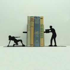 Dramatic bookends by Knob Creek Metal Arts – more (fun with silhouettes) images @ http://www.juxtapoz.com/Current/dramatic-bookends-by-knob-creek-metal-arts – Knob Creek Metal Arts, Etsy, Book End
