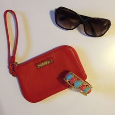 Calvin Klein Wristlet Like new, red Calvin Klein wristlet. In mint condition and comes with care card. Measures 6.5L x 4H. Sunglasses and bracelet are not included. Bracelet can be bundled for an additional cost. Please comment if you would like to bundle before purchasing. Calvin Klein Bags Clutches & Wristlets