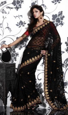 Black and gold saree with red blouse