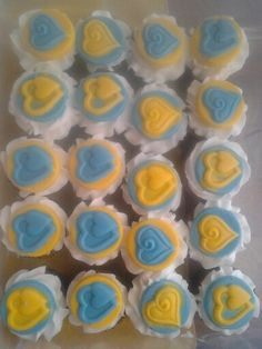 Carrot cake with Vanilla frosting and white chocolate deco.  Baby shower cupcakes. Wickedseeettreats413@gmail.com