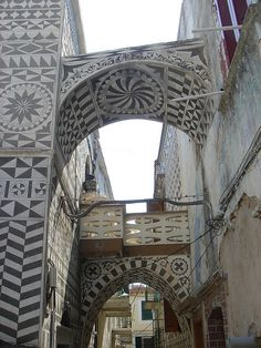 Pyrgi is a medieval village on the Greek island of Chios. Its unique architecture features facades with decorative patterns made by scraping whitewash to reveal the plaster mixed with black sand beneath. The process is called xysta.