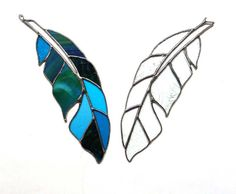 Stained glass feather created from an original drawing with amazing art glass in shades of blue. Add a little bohemian style to your home.  This stained glass piece measures 10 x 3. A small wire loop at the top is strung with clear fishing line, ready to hang in your window, or wherever you need a little color.