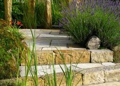 Whether they're winding through a garden or leading to your front door, a stone walkway is always a good idea. From stepping stones to paver stones and everything in between, here are some of our favorite ways to create a stone walkway or garden path. Stamped Concrete Walkway, Outdoor Walkway, Paver Walkway, Front Walkway, Backyard Patio, Garden Steps, Garden Paths, Garden Landscaping, Landscaping Ideas