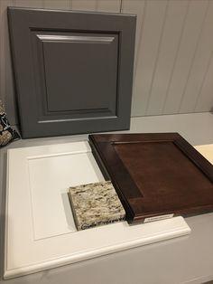 Off white cabinets and a dark island with giallo ornamental granite