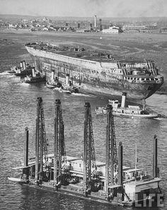 "Sending ""remains"" of the transatlantic passenger liner ""Normandie"" in the scrap metal; New York; 1946"