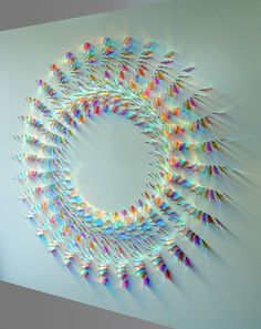 UK artist Chris Wood uses special two color glass developed by NASA in the 1950s in her large geometric installations that play with light and reflections.