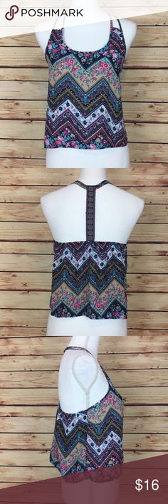 """Charlotte Russe Blue Floral Racerback Crop Top M Charlotte Russe crop top. Sleeveless. Racerback. Mixed print floral chevron. Medium.  Excellent preowned condition with no flaws.  Measurements are approximately: 31"""" bust, 37"""" waist, and 20"""" length.  100% polyester.  No trades. All items come from a pet friendly, smoke free home. Bundle to save! Charlotte Russe Tops Crop Tops"""