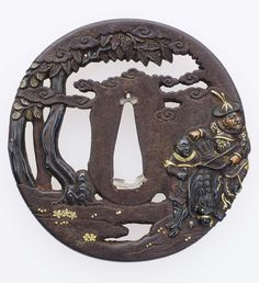Tsuba with design of Mongol archer, attendant and dog. Edo period early to mid-19th century, Yanagawa School