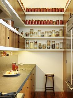I kind of like this pantry! I like the combination of sliding doors/hidden cabinets along with open shelves. #kitchen #remodel