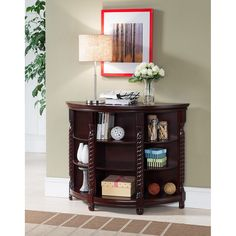 Use this console table in your living room or hallway for easy storage. This piece is made of an attractive cherry wood veneer and has plenty of shelf space for flowers, books or scented candles. Cons