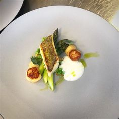 Pike perch, scallops, asparagus and peas
