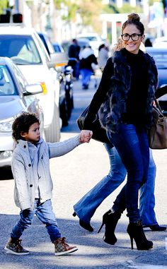For a day out shopping with the kids in Beverly Hills, Jennifer Lopez layers a furry vest over a long-sleeved shirt.