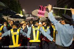"""6 Jul, 2012 GP115SJapanese """"No Nukes"""" Public ProtestJapanese policemen during a public protest against the Japanese government's nuclear energy policies, demanding a change of energy policy, and also voice their opposition to the restarting of nuclear plants which are currently offline for safety checks, in the streets near the Japanese Prime Minister's official residence, in Tokyo."""