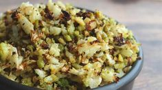 """Roasted Cauliflower """"Rice"""" - Cauliflower is pulsed until it is the size of rice and roasted until golden brown in this quick and easy recipe for a grain-free side dish. Roasted Cauliflower, Cauliflower Recipes, Cauliflower Rice, Purple Cauliflower, Roasted Carrots, Rice Recipes, Paleo Recipes, Cooking Recipes, Vegetable Recipes"""