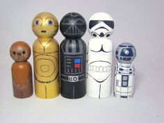 The Rebel Galactic Gang Hand Painted Wood Star Wars R by Pegged... All your favorite Star Wars characters have made it to Pegged....Luke Skywalker, Princess Leia, Hans Solo, Chewbacca, C3PO, R2D2, Yoda, a Storm Trooper, Ewok & even Darth Vader made the trip.