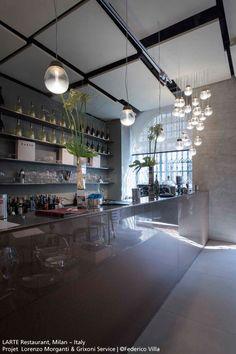 Special #Empatia suspensions (gold finish and transparent glass) #GlassCollection in the entrance of this fabulous italian restaurant ! #design Carlotta de Bevilcqua & Paola di Arianello