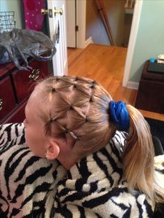 Gymnastics hairstyle! I definitely want to try this for a competition!