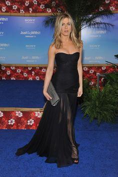 Jennifer Aniston, Dress: Dolce & Gabbana, Clutch: Burberry Alligator