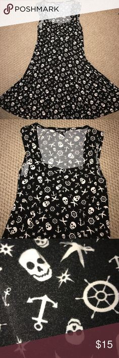 Pirate Skull Dress Pirate themed dress from Hot Topic. It's gathered at the bust and so flowy! Can fit an XL as it's so stretchy! It's slightly worn but not very noticeable. Hot Topic Dresses