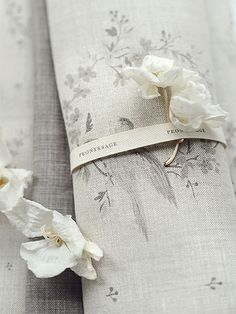 Peony and Sage - Birdsong and Co Fabric Collection - A scroll of bird and floral patterned fabric tied with white ribbon, scattered with a white flower and petals Sage Living Room, Shabby, Grey Curtains, Ruffle Curtains, Touch Of Gray, Square Patterns, Roman Blinds, White Ribbon, Fabulous Fabrics