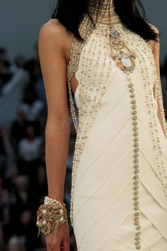 Chanel gown - exquisite. Love the bracelet layers.