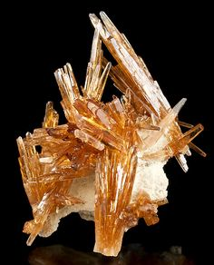 Gemmy crystals of honey colored Barite perched atop Sulfur colored matrix!  The elongated crystals of Barite are very gemmy and glassy and many have full  terminations. Broken tips are the norm for these specimens so they don't detract.  The display of the Barites is very aesthetic with clusters pointing in all directions.