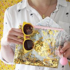 The perfect road trip essentials! Sunglasses, road map, a little treat and of course your Good As Gold Everything Pouch! It's a must to have a little gold confetti wherever you go!