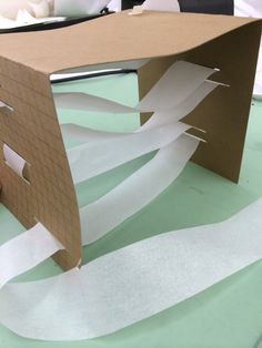 Experiment of sewing chipboard with a long strip of paper.  Paper creates landscape and also holds the chipboard standing #48105