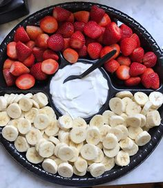 Strawberries, bananas, and yogurt look like a Poke Ball as a snack for a Pokémon-themed birthday party. Click or visit FabEveryday.com to see details and DIY instructions for a Pokémon or Pokémon Go themed kid's party, including food, decorations, favors, and party activities.