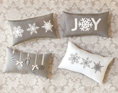 Use dingbat fonts and digital scrapbooking elements printed onto transfer paper from the hobby store and iron onto fabric to create holiday decor