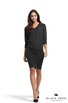 Lovely dress in stretch material. Slim at hips and loose at upper body. Black Swan Fashion