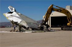 Since its retirement in 2008 the unmistakable Nighthawk Stealth Fighter, aka 'Black Jet' has been stored at the secretive Tonopah Test Range Airport. But some say the mothballed airframes could now be buried in marked graves in the Nevada Desert. Military Jets, Military Aircraft, Fighter Pilot, Fighter Jets, Fighter Aircraft, Stealth Aircraft, Us Air Force, Aviation Art, Barn Finds
