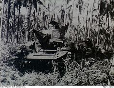 A General Stuart light tank, named Cabby, bogged in the mud is pulled out by another tank of the same type. The tanks were manned by members of the 2nd Armoured Regiment and the 6th Armoured ...