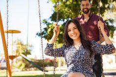 Couple having fun in a swing stock photo