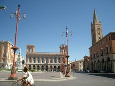 Forli, Province of Forli Cessena , Emilia Romagna region, Italy. The building at the end is (or was last time I was there) the post office.