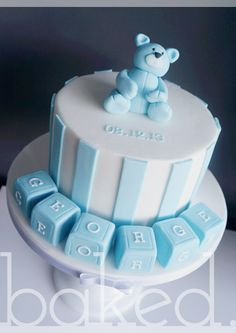 Christening Cake for baby boy with bear and baby blocks on top.