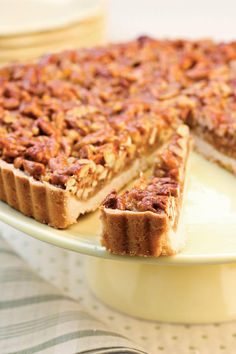 Caramel-Pecan Tart - 37 Caramel Dessert Recipes - Southernliving. Surprisingly easy to make, this pecan and caramel dessert recipe pairs the cookie-like crispness of shortbread with a buttery-rich brown sugar-and-honey topping.  Recipe: Caramel-Pecan Tart