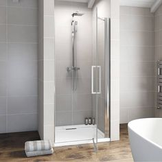 This frameless shower door creates a distinct feature whilst offering the best you could want in terms of shower enclosure manufacturing. A contemporary chrome bar handle is used to complete the ultra modern shower enclosures designer look. Loft Ensuite, Stone Shower, Yellow Tile, New Bathroom Ideas, Frameless Shower Doors, Modern Shower, Wet Rooms, Safety Glass, Shower Enclosure