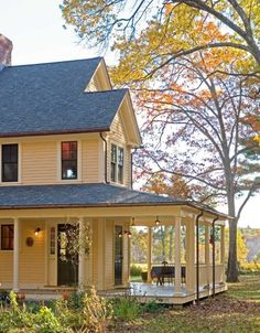 Stunning yellow farmhouse This reminds me of the Farm house I grew up in …..I would Love to have this porch !!!!!!