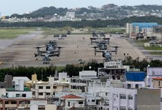 epa04756429 US Marine Corps MV-22 Osprey aircrafts are sitting on the tarmac at US Marine Corps Air Station Futenma surrounded by overcrowded residential areas in Ginowan on Okinawa Island, southwestern Japan, 19 May 2015. Japanese government just announced on May 12 that CV-22 Ospreys would be deployed to the U.S. Air Force's Yokota base on the outskirt of Tokyo. CV-22 Ospreys is for special operations forces, engage in low-altitude and nighttime flights, and the accident rate is three…
