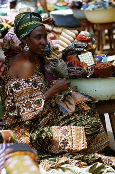 A woman sells fabric
