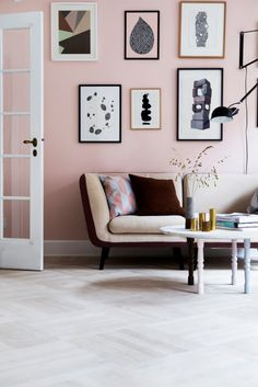 pink wall, gray floor, black and white art // sitting room