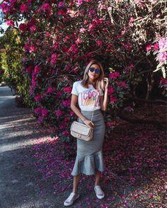 Nelie Lim wearing Pedro García Parson satin sneakers in pink