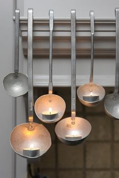 "Check out this ladle ""candlestick"" idea! I'm impressed. (Remodelista)"